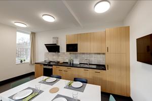 Gemeinschaftsküche: Ausstattung einer moeblierten 1-Zimmer-Wohnung (STUART Student Apartments, Hamburg)